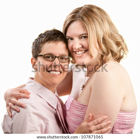 Two happy friends embrace over white background