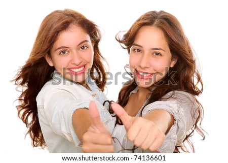 Two happy friends smiling at the camera with a gesture of ok on their hands - stock photo