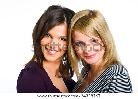 Two happy girlfriends beside - stock photo