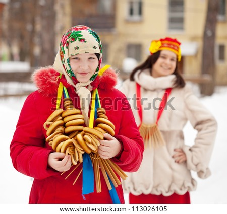 Two happy girls celebrating  Shrovetide  at Russia