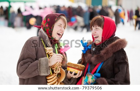 Two happy girls celebrating  Shrovetide  at Russia - stock photo
