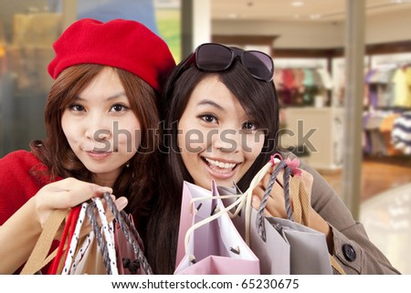 Two happy girls in a shopping center - stock photo
