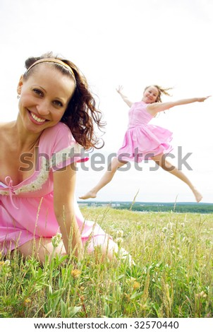 Two happy girls in pink - stock photo