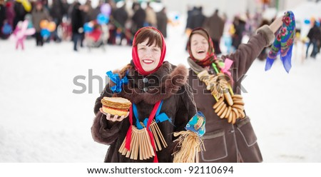 Two happy girls plays during Shrovetide at Russia - stock photo