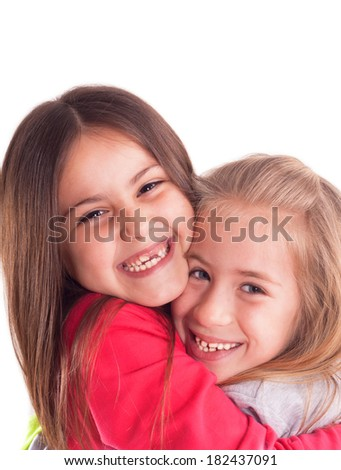 two happy girls smiling