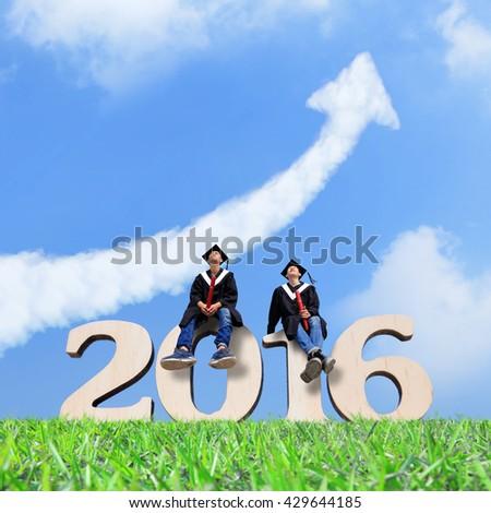 Two happy graduates student look sky , asian - stock photo
