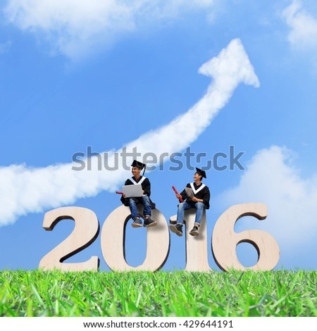 Two happy graduates student use digital tablet pc and laptop computer with sky , asian - stock photo