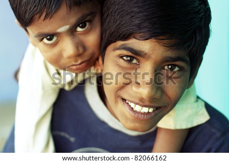 Two happy Indian boys posing to the camera. - stock photo