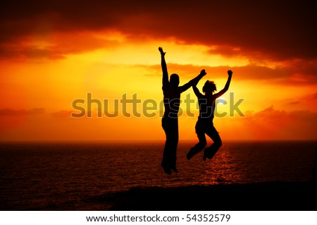 Two Happy Jumping People - stock photo