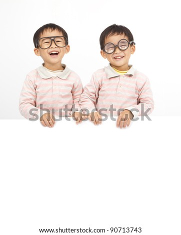 two happy kids behind white board - stock photo