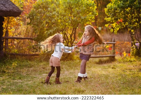 Two happy kids having fun the park. Autumn concept - stock photo