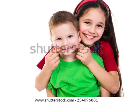 Two happy kids playing together, isolated on white - stock photo