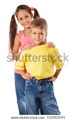 Two happy kids standing together and embracing, isolated on white - stock photo