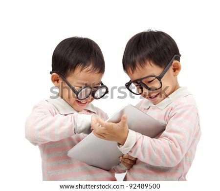 two happy kids using touch pad computer  and isolated on white - stock photo