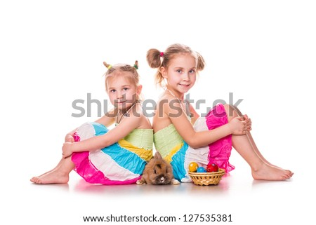 Two happy kids with easter bunny and eggs isolated on white. Happy Easter - stock photo