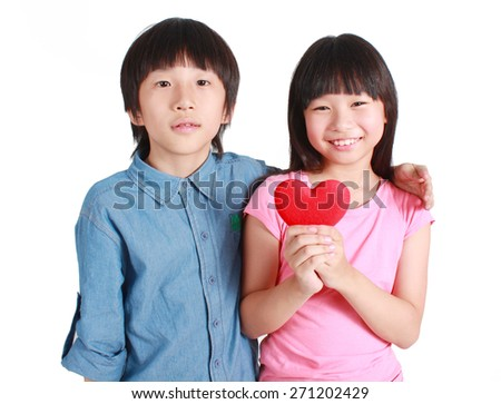 Two happy kids with valentines heart  - stock photo