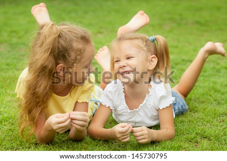 two happy little girls in the park - stock photo