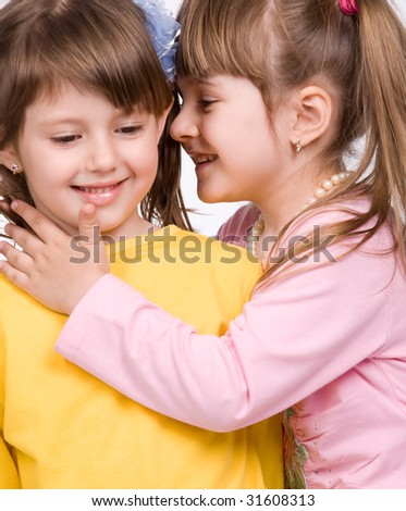 Two happy little girls on white background - stock photo
