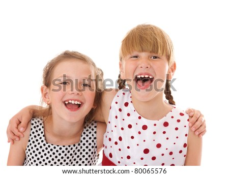 Two happy little sisters portrait isolated on white - stock photo