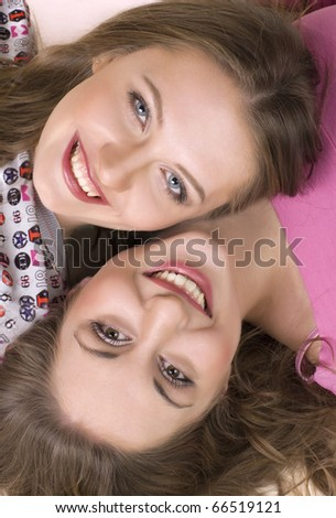 two happy  merry girls - stock photo