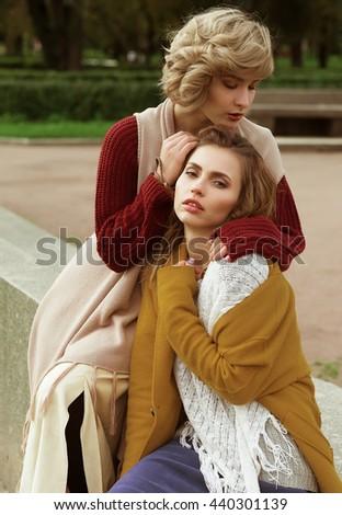Two happy pretty young women, fashion shooting - stock photo
