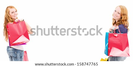 two happy redhead women with shopping bags on white background with copyspace - stock photo