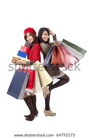Two happy shopping  beautiful girls with the bags - stock photo