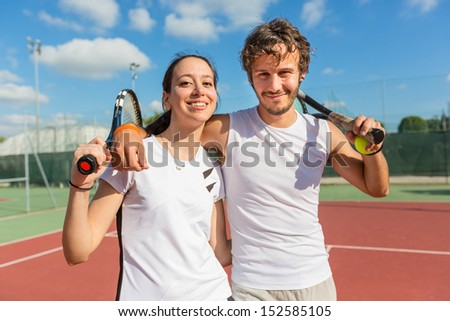 Two Happy Tennis Players - stock photo
