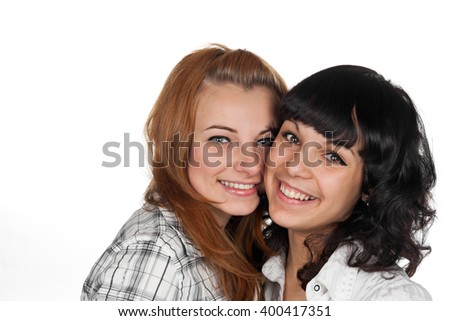 Two happy woman friends laughing