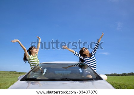 two happy woman  in the car and enjoy vacation - stock photo