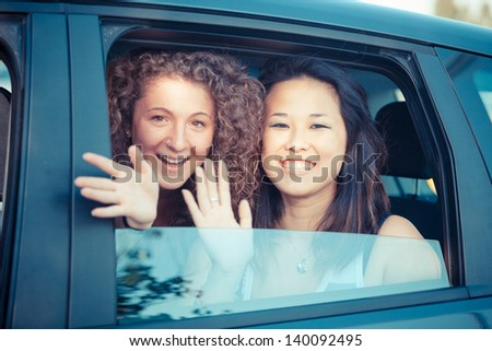 Two Happy Women in the Car - stock photo