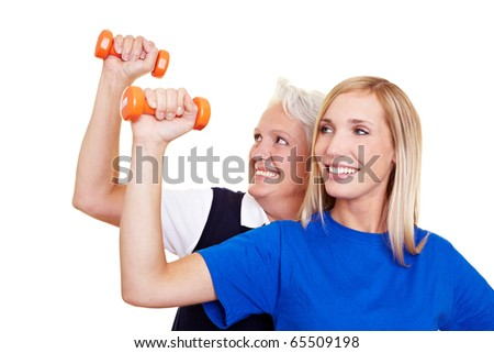 Two happy women training with small dumbbells