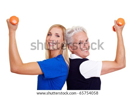 Two happy women training with small dumbbells - stock photo