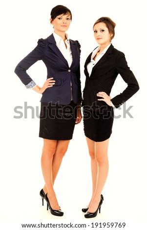 two happy young business women standing and smiling, white background
