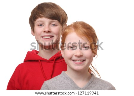 Two happy young children on white background