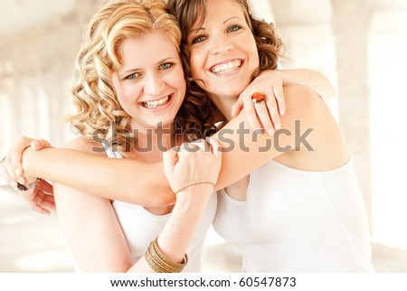 two happy young girlfriends - stock photo
