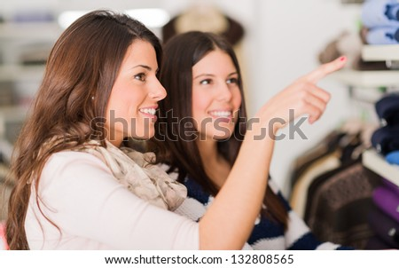 Two Happy Young Women Shopping In Mall, Indoors - stock photo