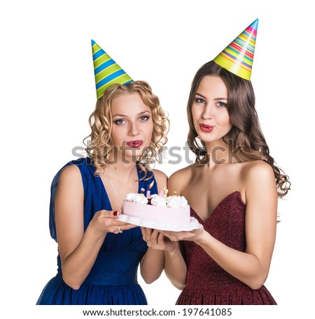 Two happy young women with cake - stock photo