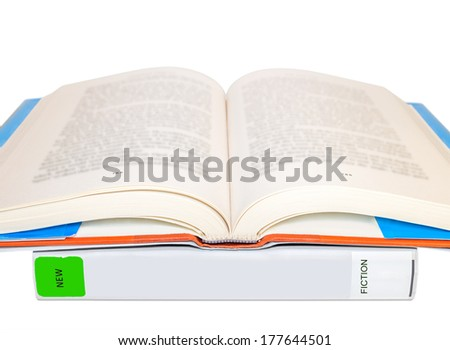 Two hardcover public library books protected by book covers.Closed new fiction book with green sticker.Book on top open with page numbers,blurred text.Isolated on a white background.Horizontal photo.  - stock photo