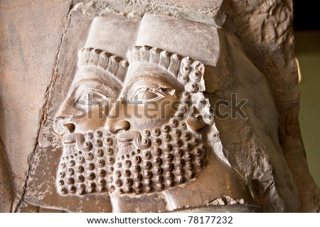 Two heads, Ancient bas-reliefs of Persepolis, Iran - stock photo