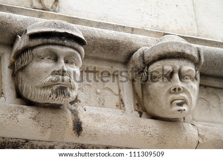 Two heads on the wall of cathedral in Shibenik, Croatia