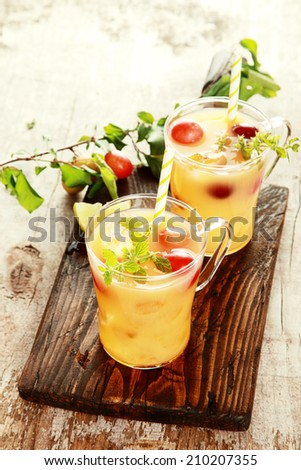 Two Healthy Delicious Fruit Juices on Wooden Table. Good for Detoxifying.