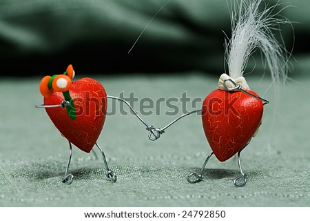 Two heart shape puppets