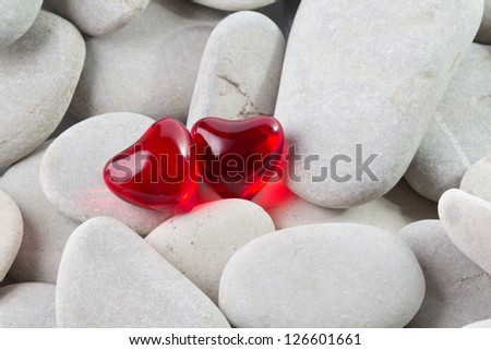 Two heart shaped bath pearls and stones - stock photo