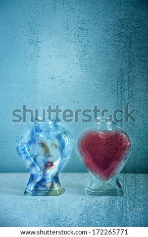 Two heart shaped bottles with conceptual message - stock photo