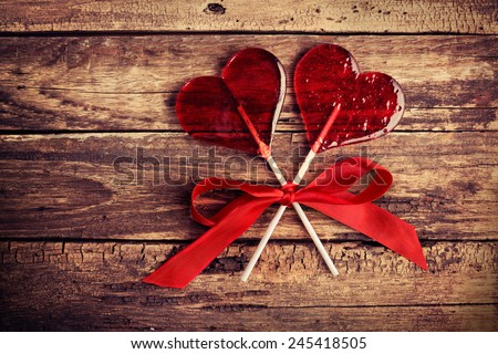 Two heart-shaped candy, Valentines Day background, wedding day - stock photo