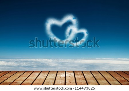 Two heart shaped clouds in the blue sky - stock photo