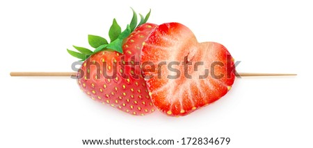 Two heart-shaped strawberries  on a stick isolated on white (valentine's day concept) - stock photo