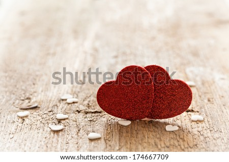 two heart shapes on wood with copy space  - stock photo