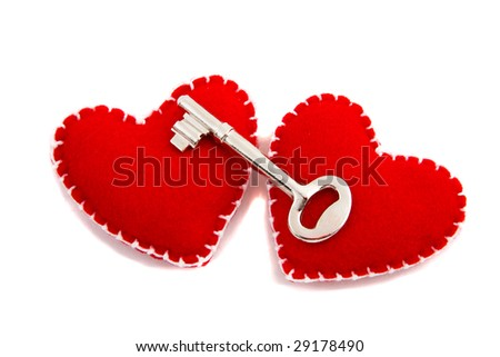 Two Hearts and a Key to signify opening of one's heart to love - stock photo